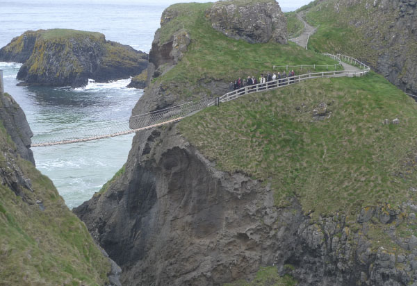 People crossing Carrick-a-Rede rope bridge near Lissanoure Castle