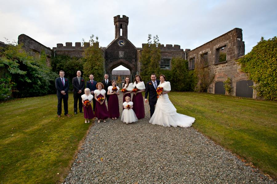 Group wedding photograph at Lissanoure Castle down by the lake.